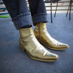 Gold boots fashion concept shot