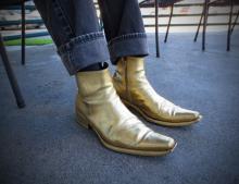 Gold boots fashion concept shot